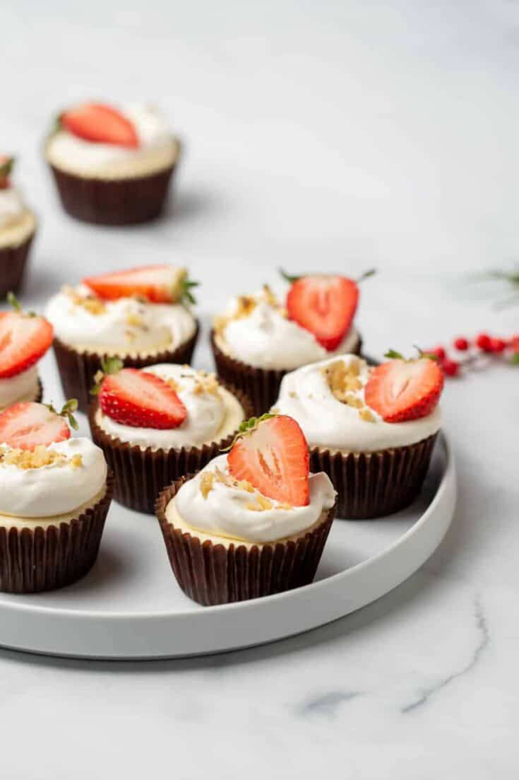 Low Carb Mini Cheesecakes boast a rich and creamy filling on top of a flavorful walnut crust. These mini cheesecakes are so good, you won't even realize they're low carb!