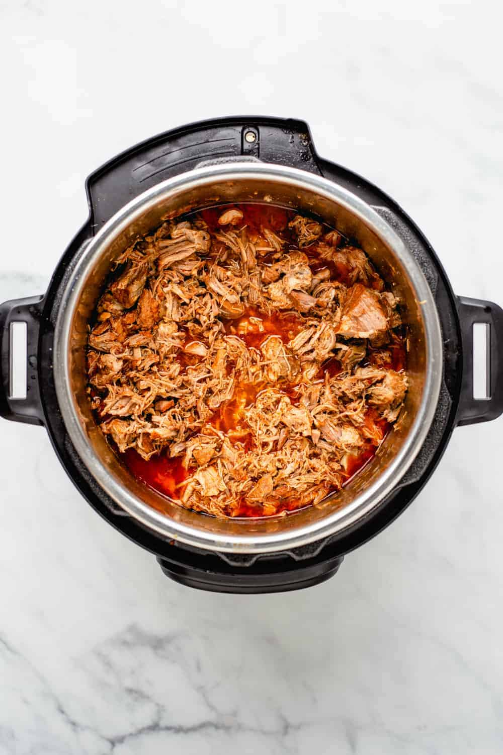 Instant Pot Pulled Pork is as fast and easy as it is delicious.