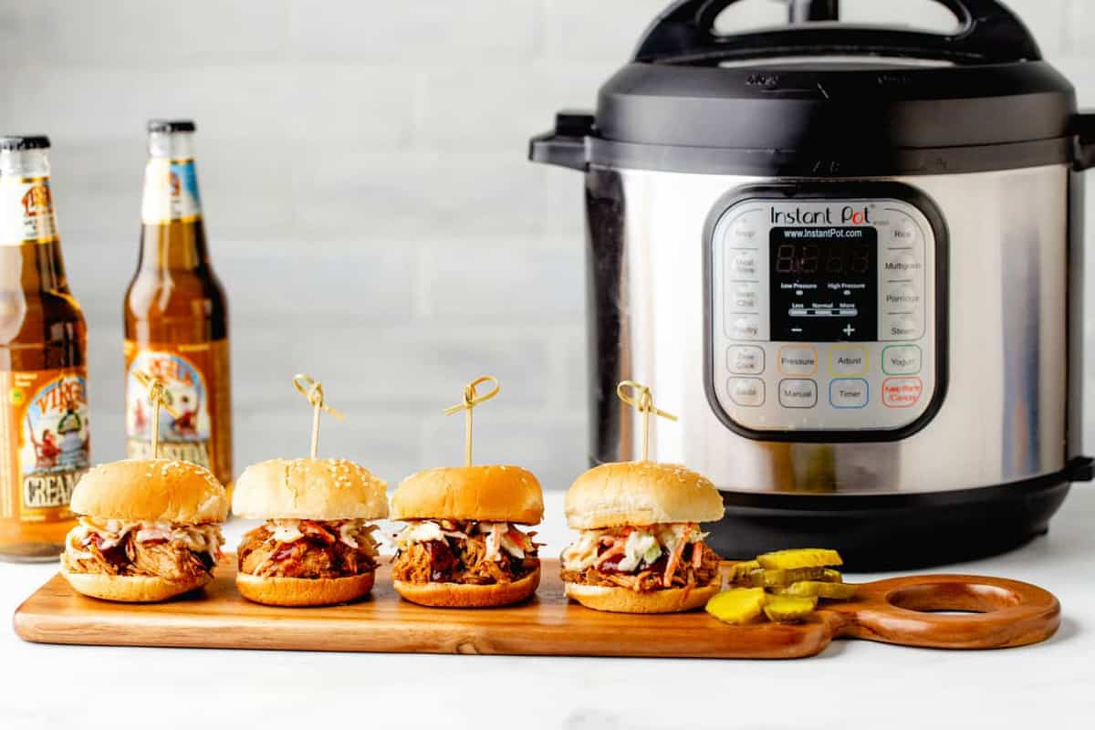 Tangy and succulent, Instant Pot Pulled Pork is every bit as easy and delicious as the slow cooker version.
