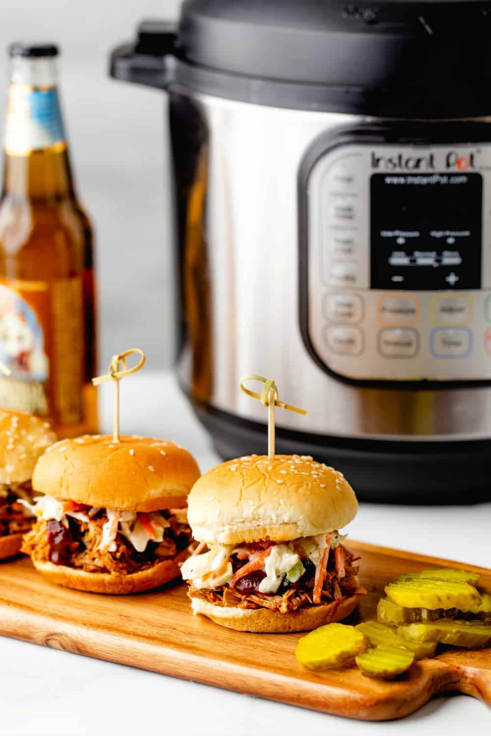 Instant Pot Pulled Pork is just as tangy and juicy as the slow cooker version, but comes together in a fraction of the time.
