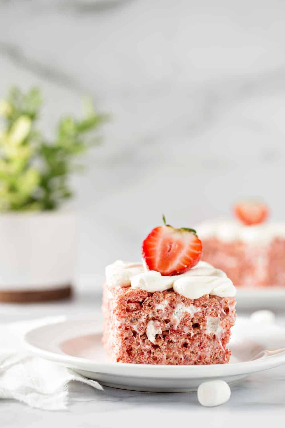 Strawberry Rice Krispie Treats are simple and totally delicious for spring! Ooey, gooey and loaded with strawberry flavor!