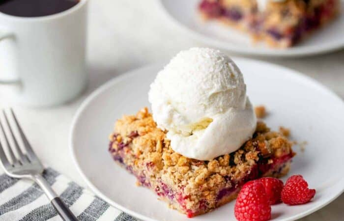 Top Berry Crumble Bars with a scoop of ice cream for a delicious spring dessert
