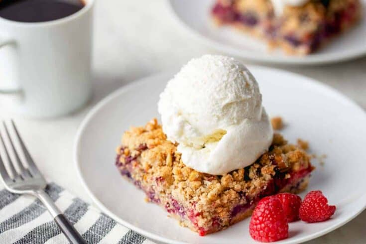 Berry Crumble Bars are bursting with fresh mixed berries and topped with a pecan-studded crumble. These bars are easy to make and perfect to serve at any spring brunch or party.