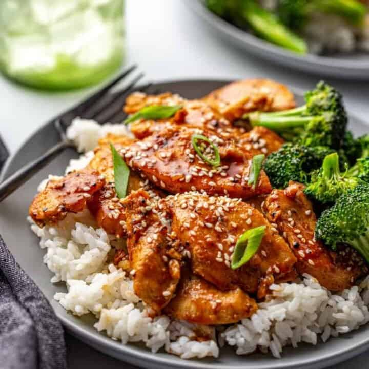 Honey Soy Chicken plated with broccoli on top of rice.