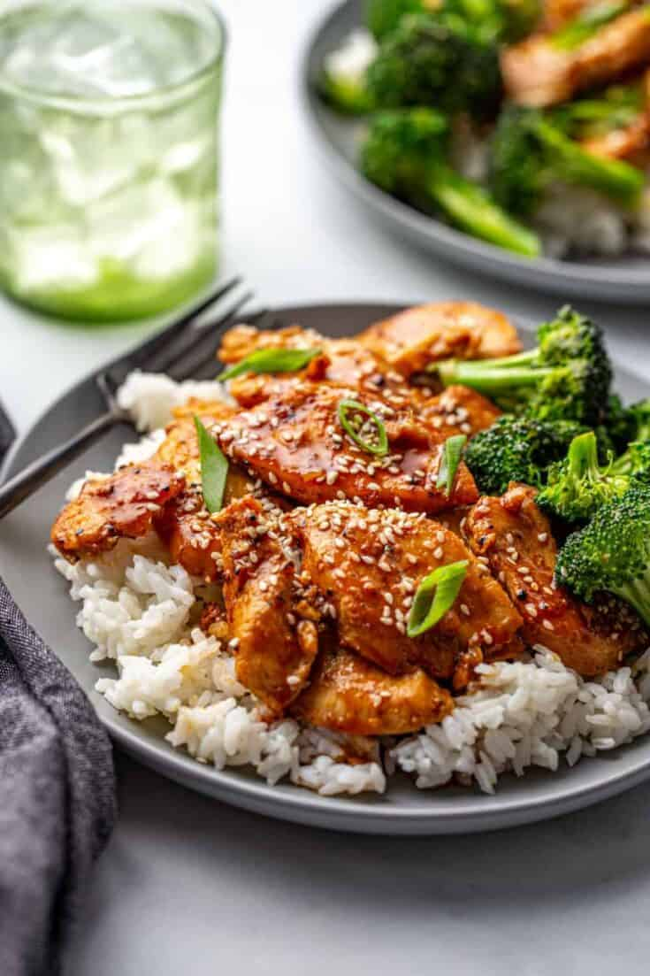 Honey Soy Chicken and Rice is a great weeknight family dinner. Chicken and broccoli cooked in a sweet and sticky sauce flavored with garlic and ginger is served over rice for a complete meal in one bowl. Forget take-out – this is just as easy and far more delicious!