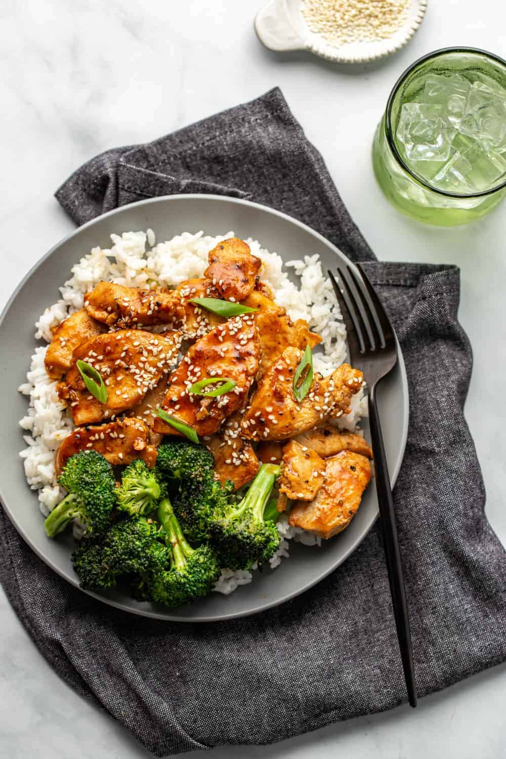 Overhead view of honey soy chicken and broccoli plated with rice