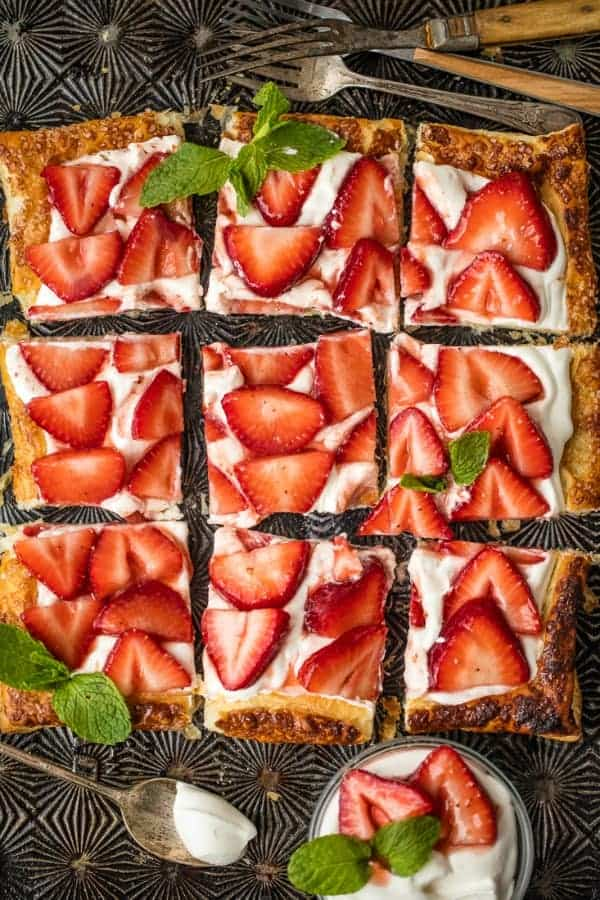 Sliced strawberries over mascarpone filling in a puff pastry tart shell