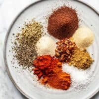 Spices for homemade taco seasoning arranged on a plate
