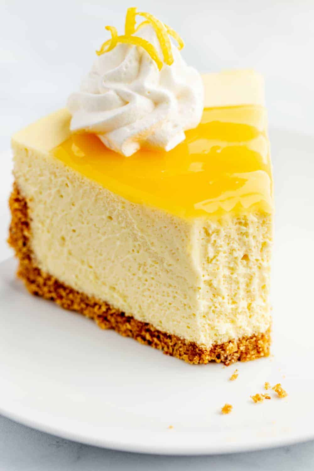 Slice of lemon cheesecake with a bite taken