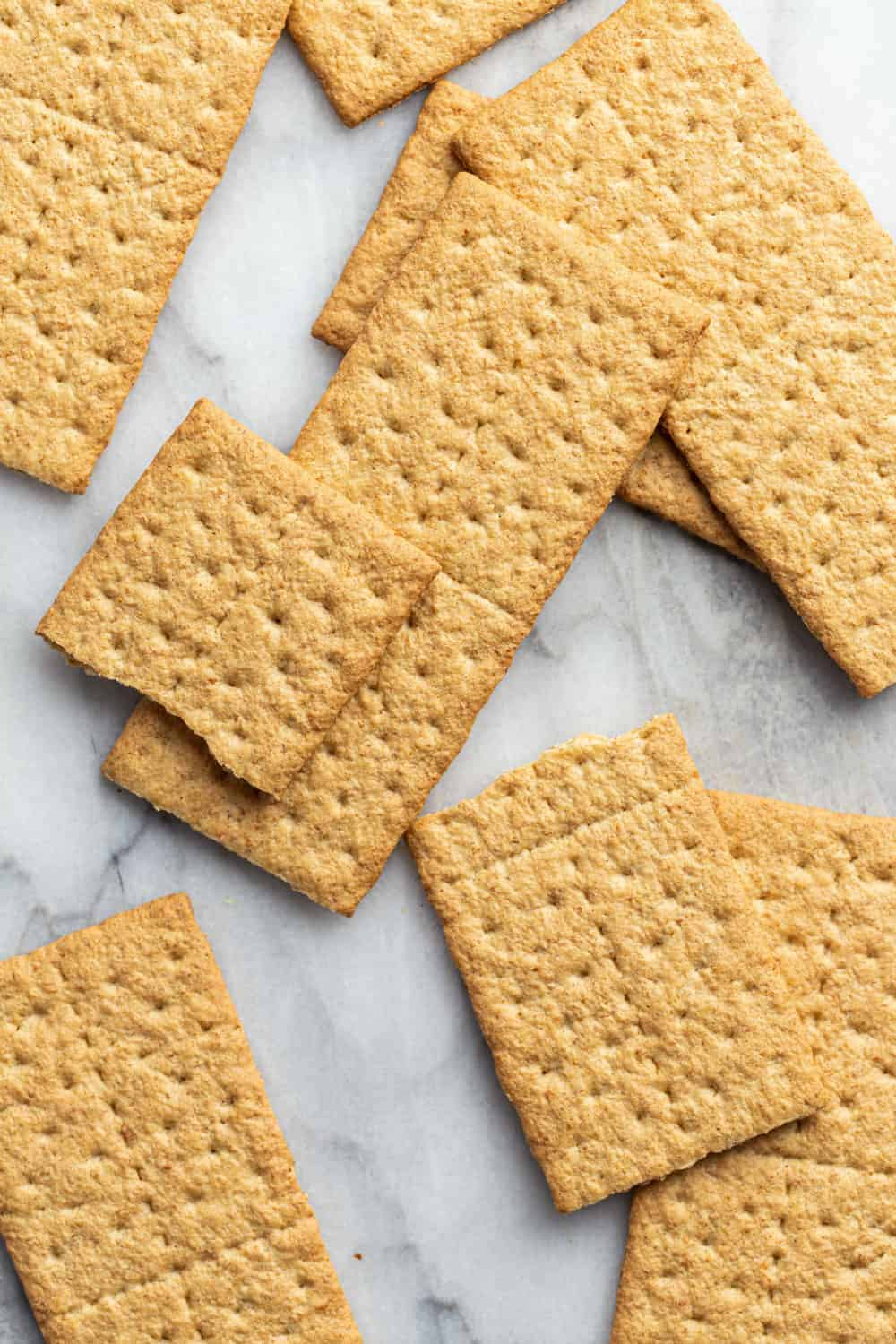 Whole graham crackers on a marble surface