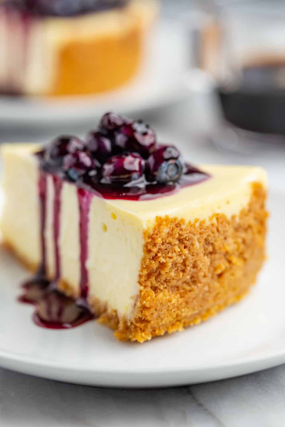 Slice of cheesecake with close up of the graham cracker crust