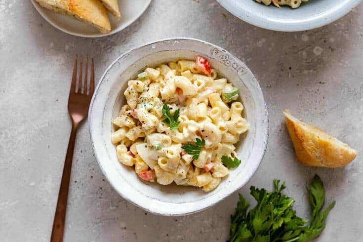 Amish Macaroni Salad is a potluck classic! This pasta salad combines cooked macaroni, hard-boiled eggs, crispy veggies and a creamy dressing for a side dish your friends will ask for again and again.