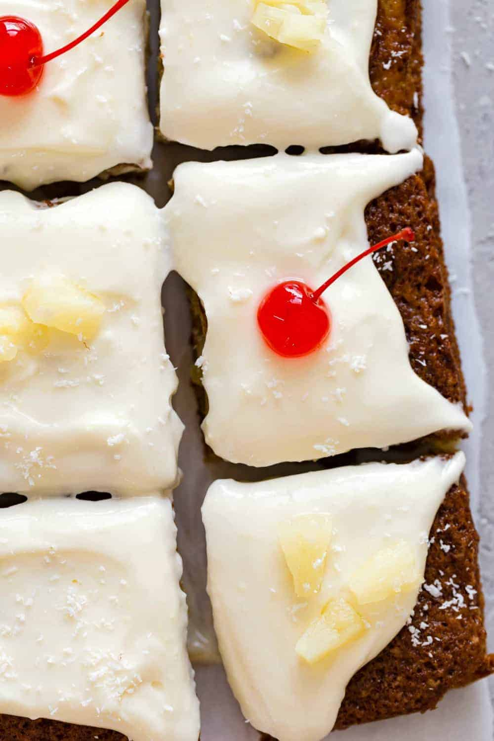 Sliced pineapple cake topped with cherries and pineapple