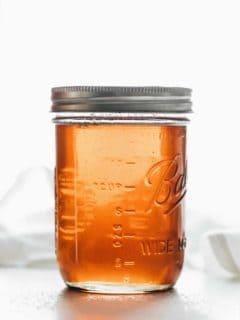 Vanilla coffee syrup in a glass mason jar
