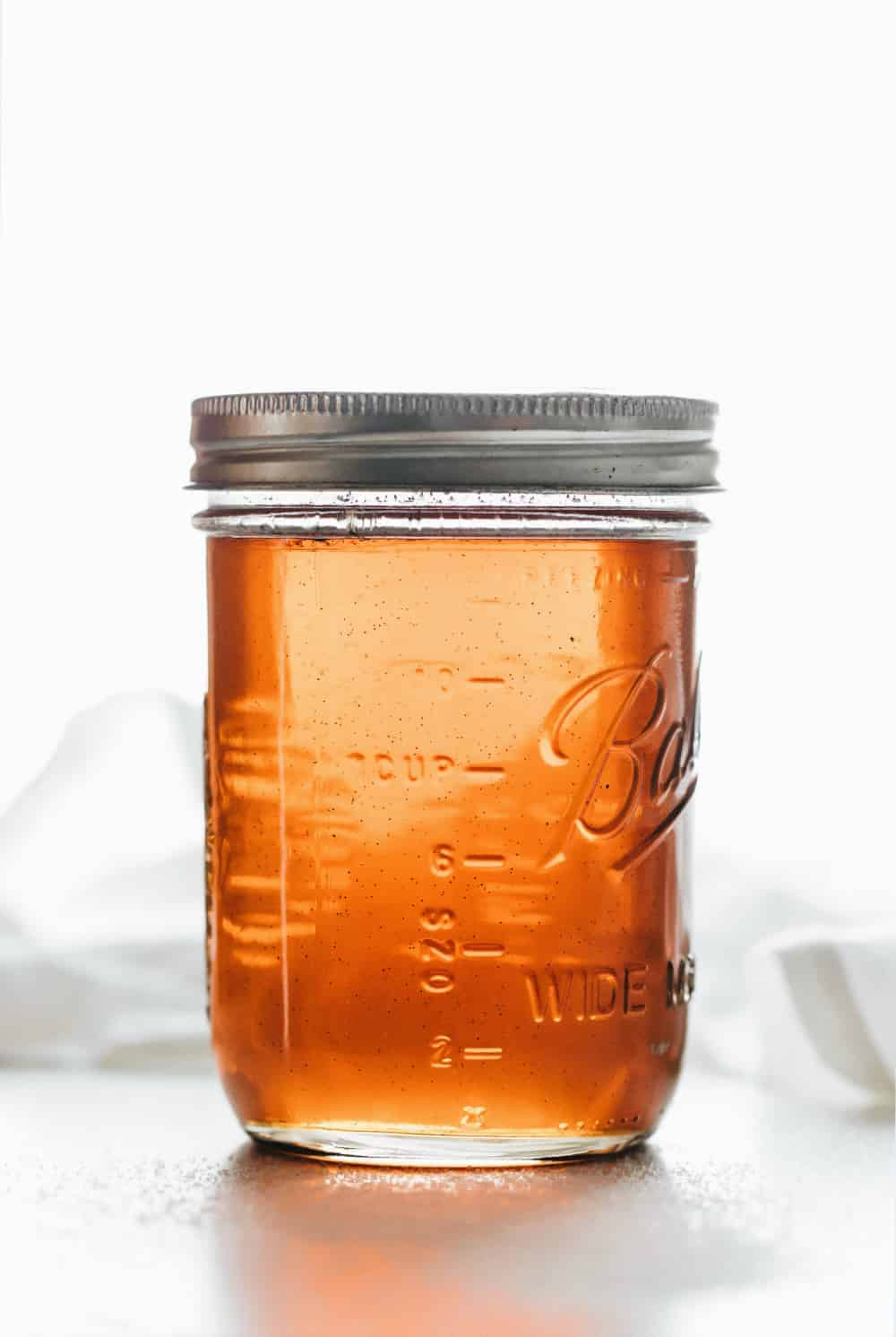 Vanilla coffee syrup in a glass mason jar