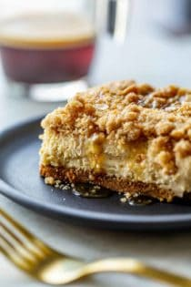 Close-up side view of a sliced maple streusel cheesecake bar