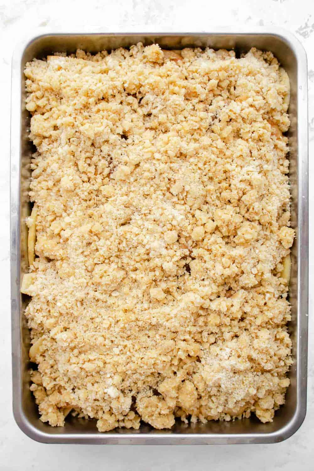 Apple crisp in a pan, ready to be baked