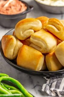 Close up of baked parker house rolls, showing the folded shape