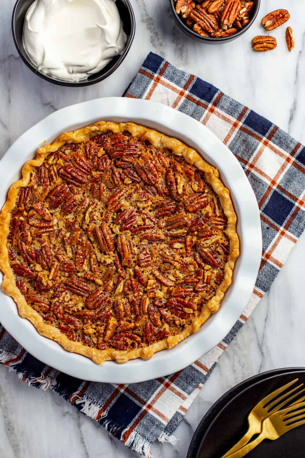 Baked classic pecan pie in a white pie dish