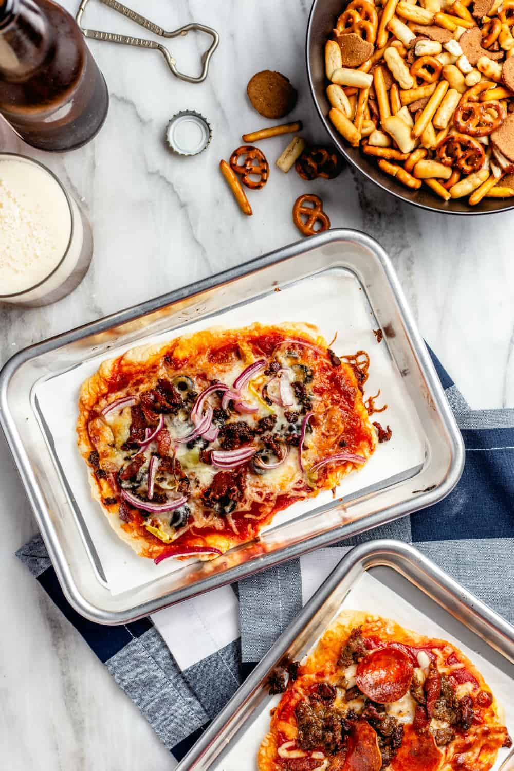 Baked individual pizzas from a DIY pizza bar on mini baking sheets