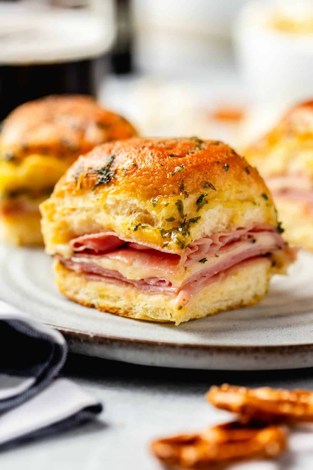Close up of plated ham and cheese slider on a white plate