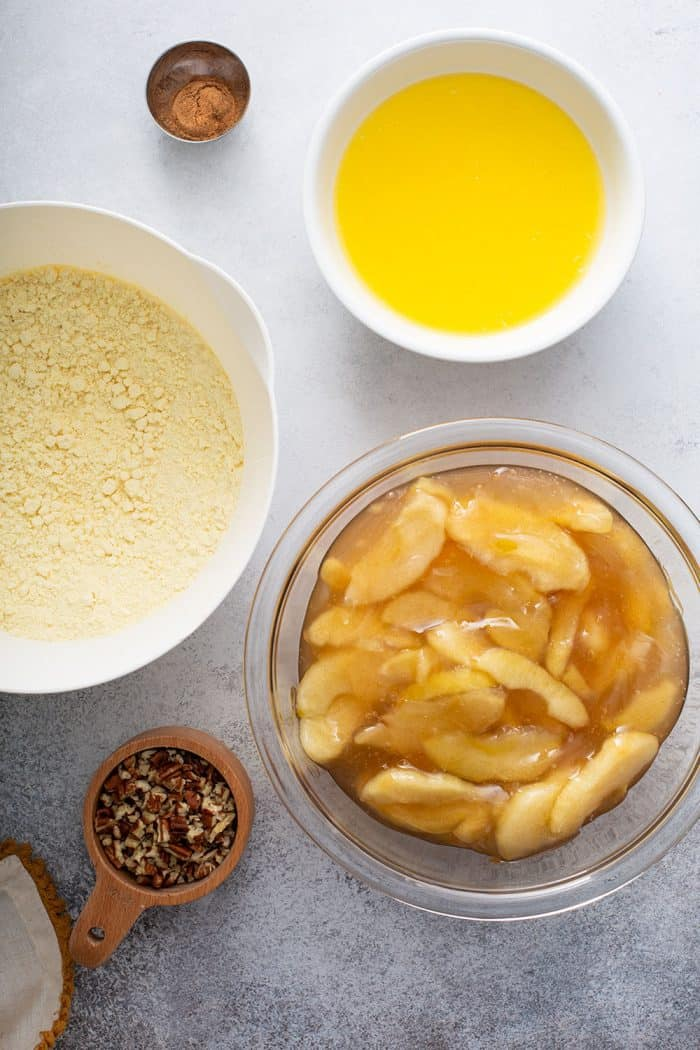 Ingredients for apple dump cake arranged on a gray counter