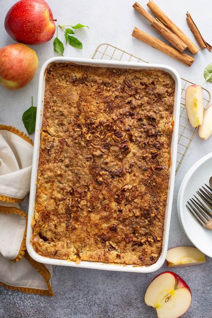 Overhead view of baked apple dump cake in a white cake pan