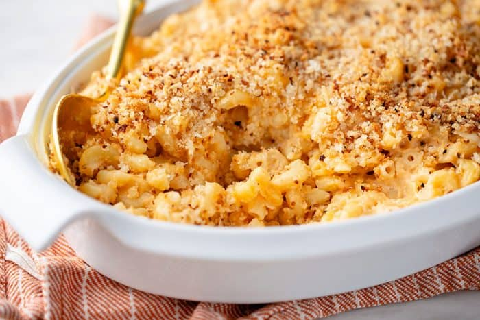 Close up of baked macaroni and cheese in a white casserole dish