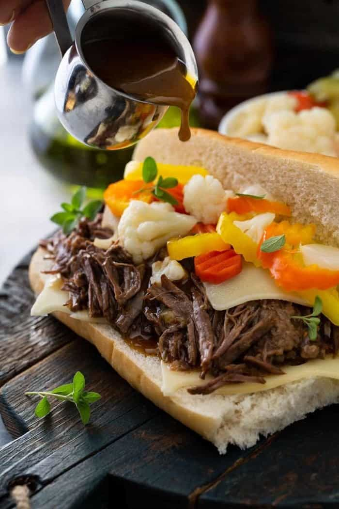 Assembled italian beef sandwich on a wooden board