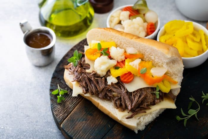Italian beef sandwich on a wooden board