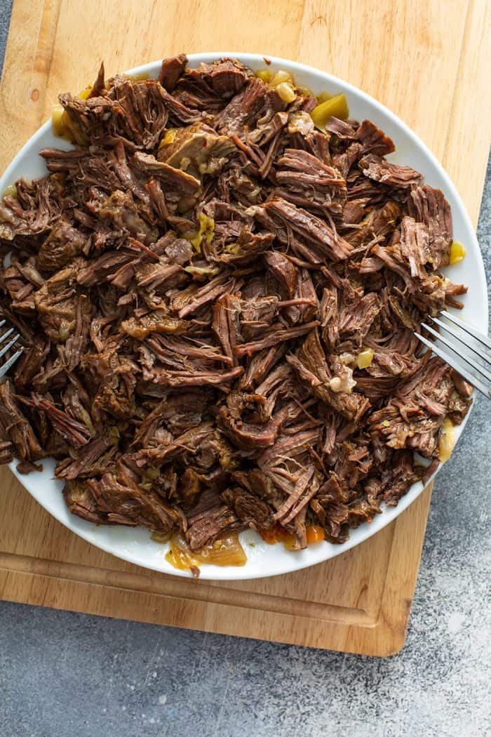 Shredded italian beef on a white plate