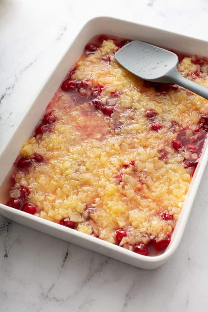 crushed pineapple and cherry pie filling layered in a cake pan