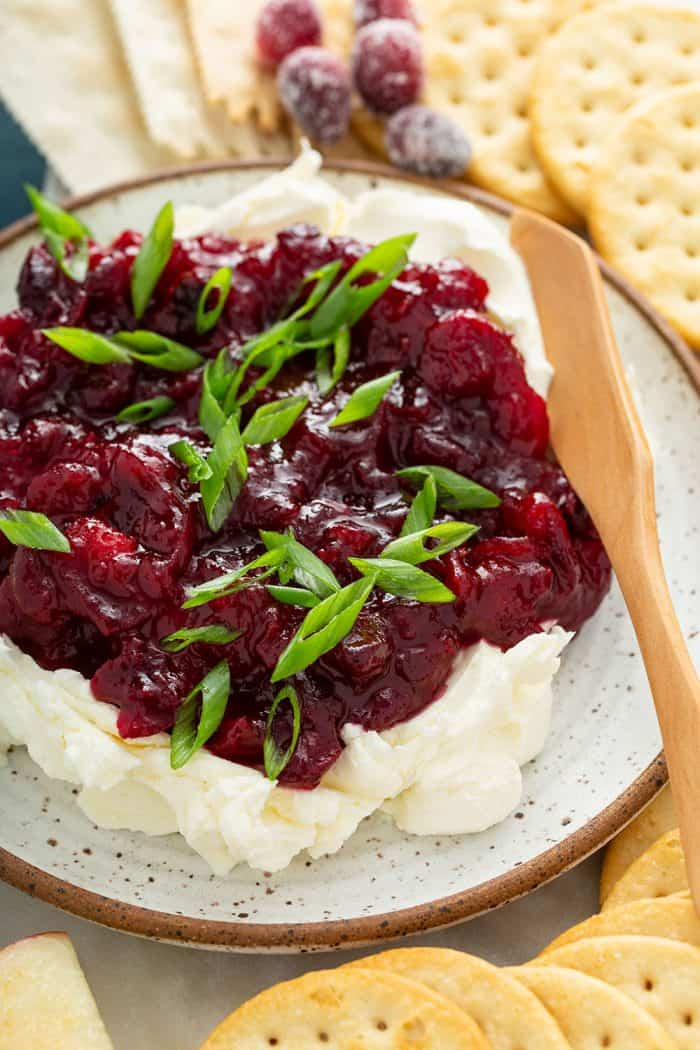 Close up of cranberry cream cheese dip on a plate