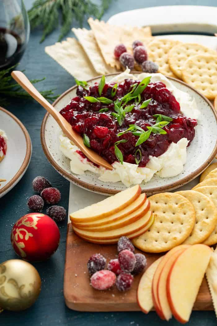 Cranberry cream cheese dip with a wooden serving knife