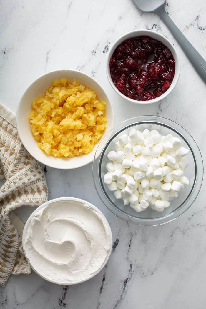 Ingredients for cranberry fluff on a marble counter