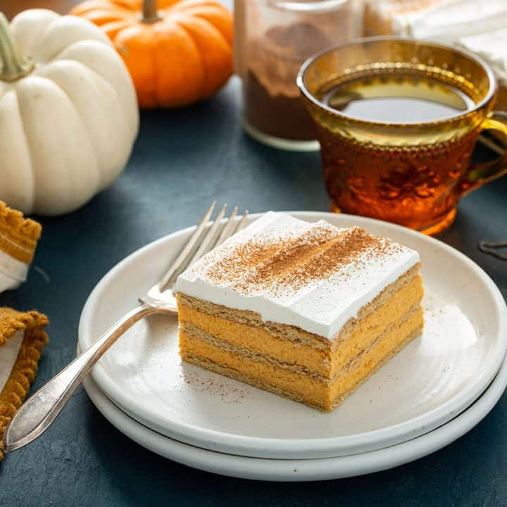 Plated slice of pumpkin eclair cake next to a fork