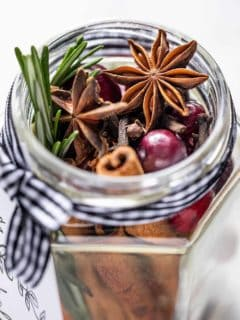 Close up of the open mouth of a glass jar filled with stovetop potpourri
