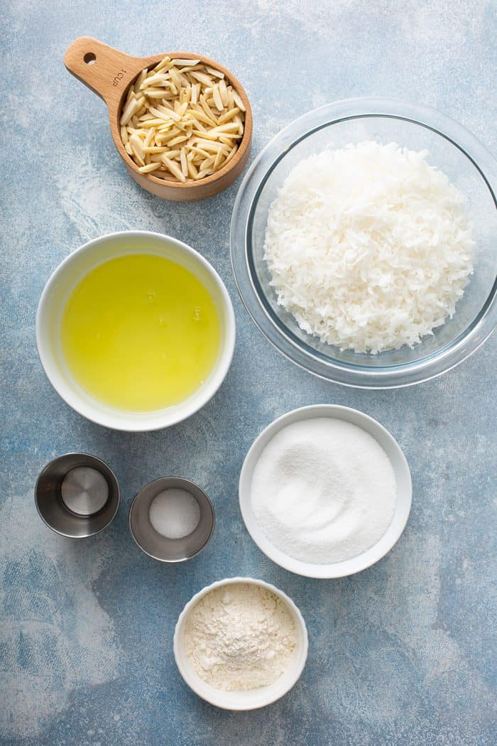 Ingredients for coconut macaroons on a blue countertop