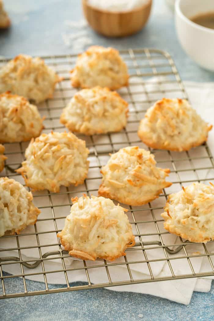 Baked coconut macaroons on a metal cooling rack