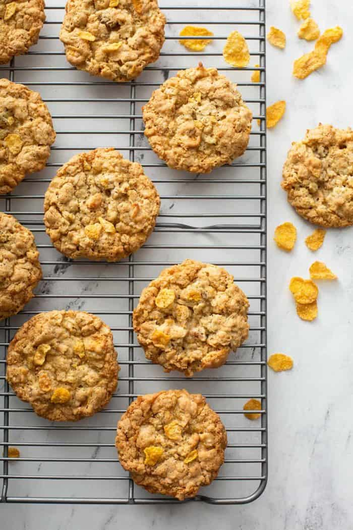 Cornflake cookies cooling on a wire rack