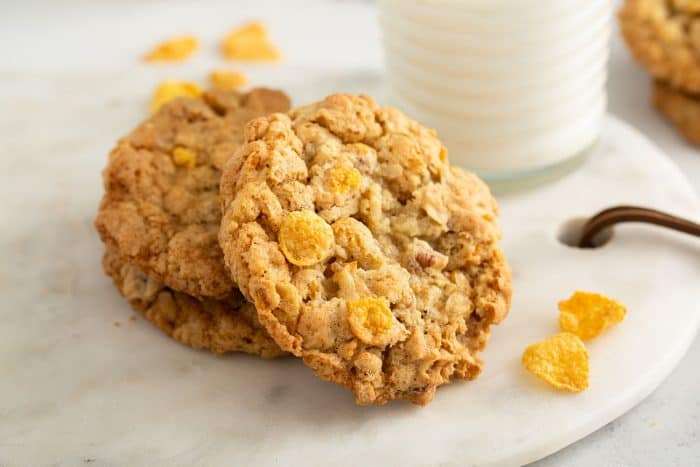 Cornflake cookies stacked on a marble platter