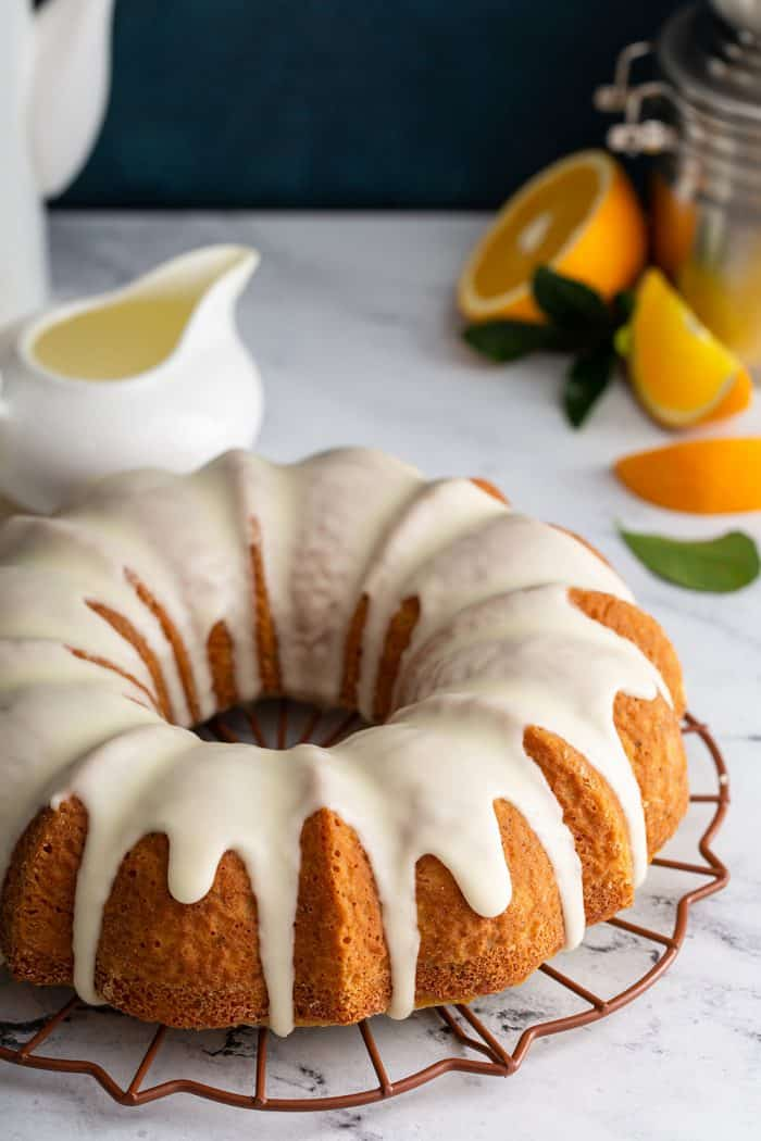Glazed citrus bundt cake on a marble counter