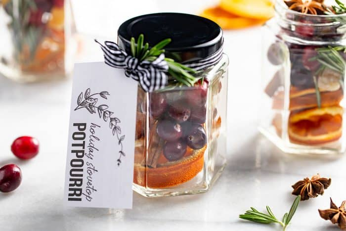 Stovetop potpourri ready for gifting in a glass jar with a gift tag