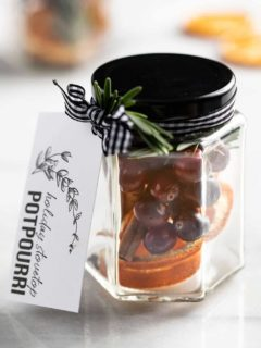 Stovetop potpourri in a glass jar with a gift tag tied to it