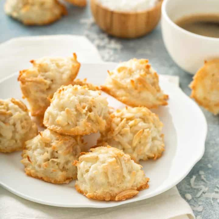 Coconut and almond macaroons arranged on a white plate