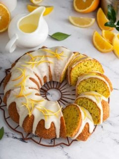 Sliced citrus poppy seed cake topped with glaze and citrus zest