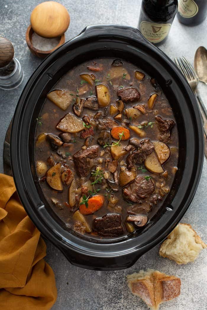 Overhead view of cooked beef and barley stew in a slow cooker
