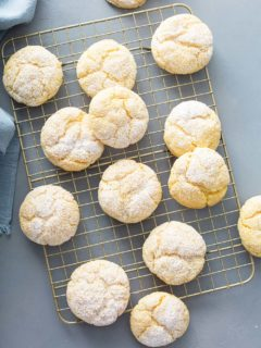 Baked gooey butter cookies arranged on a wire cooling rack