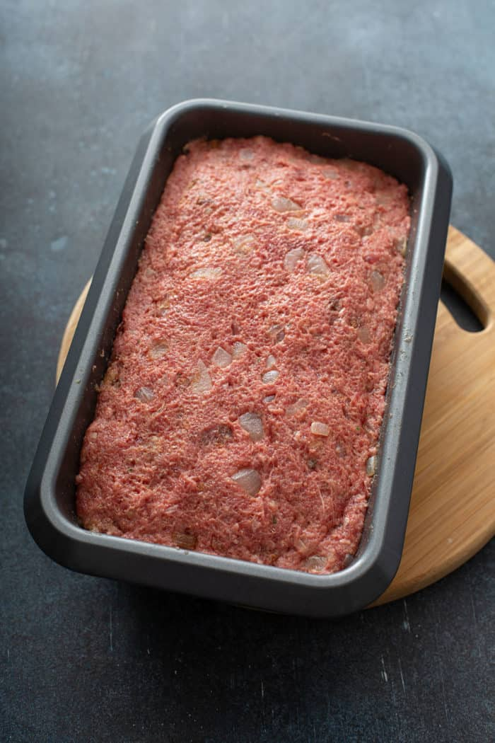 Meatloaf mix in a loaf pan, ready to be baked