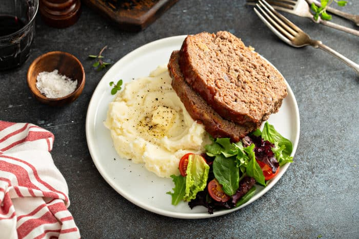 Plated easy meatloaf with mashed potatoes and green salad